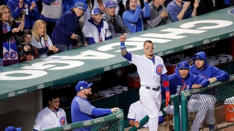 Chicago Cubs' Javier Baez comes out for a curtain call after his home run in the fifth inning against the Los Angeles Dodgers in Game 4 of baseball's National League Championship Series, Wednesday, Oct. 18, 2017, at Wrigley Field in Chicago. (Steve Lundy/Daily Herald via AP)