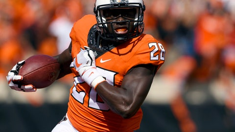 FILE - In this Sept. 23, 2017, file photo, Oklahoma State wide receiver James Washington (28) runs with the ball during an NCAA college football game against TCU in Stillwater, Okla. Oklahoma State faces Texas on Saturday. (AP Photo/Brody Schmidt, File)