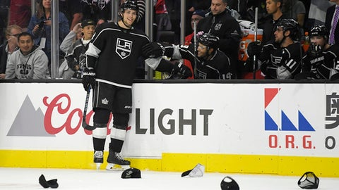 Los Angeles Kings left wing Adrian Kempe, left, of Sweden, stands at his bench while hats rain down on the ice after scoring his third goal of the game during the third period of an NHL hockey game against the Montreal Canadiens, Wednesday, Oct. 18, 2017, in Los Angeles. The Kings won 5-1. (AP Photo/Mark J. Terrill)