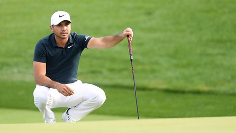 Jason Day of Australia lines up his putt during the first round of the CJ Cup at Nine Bridges, as the first official PGA Tour in South Korea, on Jeju Island, South Korea, Thursday, Oct. 19, 2017. (Park Ji-ho/Yonhap via AP)