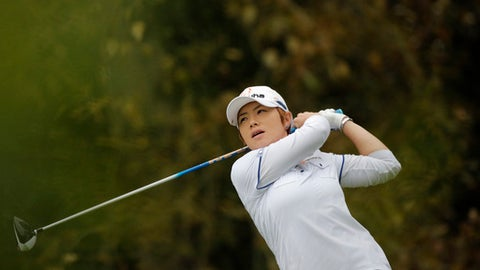 Eun-Hee Ji of South Korea follows the flight of her ball after playing on the 13th hole during the third round of the Evian Championship women's golf tournament in Evian, eastern France, Saturday, Sept. 17, 2016. (AP Photo/Laurent Cipriani)