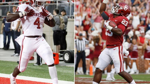 FILE - At left, in a Sept. 10, 2017, file photo, Oklahoma running back Trey Sermon celebrates a touchdown against Ohio State during an NCAA college football game in Columbus, Ohio. At right, in a Sept. 16, 2017, file photo, Oklahoma running back Abdul Adams (23) celebrates after scoring a touchdown against Tulane during the second quarter an NCAA college football game in Norman, Okla. Seven of the league's top-rated rushers were underclassmen as the league reached the midway point of the season, led by Oklahoma State's Justice Hill, Iowa State's David Montgomery and Oklahoma's talented duo of Trey Sermon and Abdul Adams.  (AP Photo/File)