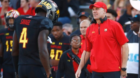 FILE - In this Oct. 14, 2017, file photo, Maryland head coach DJ Durkin stands on the sideline as safety Darnell Savage comes off the field in the first half of an NCAA college football game against Northwestern, in College Park, Md. Maryland, who's defense allowed 99 points and 1,115 yards the previous two weeks, takes on Wisconsin on Saturday. (AP Photo/Patrick Semansky, File)