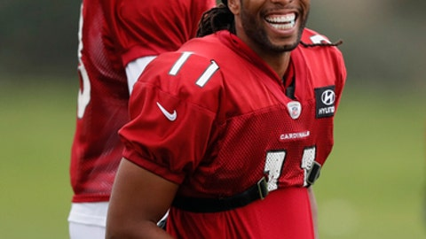 Wide receiver Larry Fitzgerald, right, and running back Adrian Peterson of the Arizona Cardinals laugh during an NFL training session at the London Irish rugby team training ground in the Sunbury-on-Thames, a suburb of south west London, Thursday, Oct. 19, 2017. The Arizona Cardinals are preparing for an NFL regular season game against the Los Angeles Rams in London on Sunday. (AP Photo/Kirsty Wigglesworth)