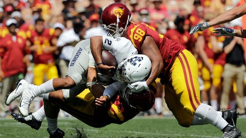 FILE - In this Sept. 10, 2016, file photo, Southern California nose tackle Josh Fatu (98) helps  defensive end Porter Gustin(45) sack Utah State quarterback Kent Myers(2) during the second half of an NCAA college football game in Los Angeles. The No. 11 Trojans are preparing to play without Fatu. Coach Clay Helton said Wednesday, Oct. 18, 2017, that Fatu was not expected to be cleared from a concussion he suffered in a car accident in time to play against the Fighting Irish on Saturday. (AP Photo/Jae C. Hong, File)
