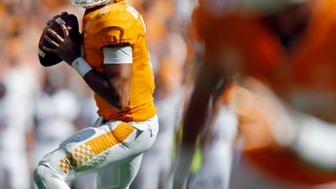 FILE - In this Oct. 14, 2017, file photo, Tennessee quarterback Jarrett Guarantano (2) looks for receiver in an NCAA college football game against South Carolina in Knoxville, Tenn. Guarantano has been phoning a few friends to get an idea of what to expect Saturday when he faces No. 1 Alabama in his first career road start. Guarantano concedes he can't fully understand what he will encounter until he steps onto the field. (AP Photo/Wade Payne, File)
