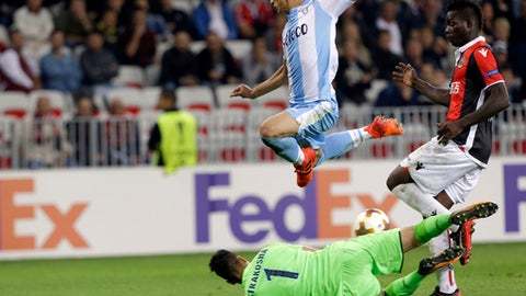 Lazio's Luiz Felipe, top, jumps over his goalkeeper Thomas Strakosha while Nice's Mario Balotelli, right, tries to score his second goal during a Europa League group K soccer match between OGC Nice and Lazio at the Allianz Riviera stadium in Nice, French Riviera, Thursday, Oct. 19, 2017 (AP Photo/Claude Paris)