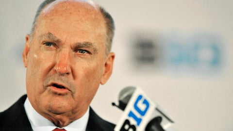 FILE - In this July 28, 2014, file photo, Big Ten Commissioner Jim Delany talks to the media during the Big Ten Football Media Day in Chicago.  The Big Ten will make its NCAA college basketball conference tournament debut at the Garden. The championship game, traditionally played on selection Sunday, will be played a week earlier on March 4. (AP Photo/Paul Beaty, File)