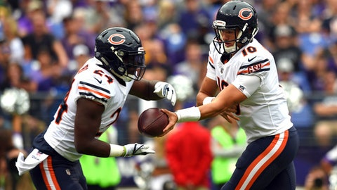 FILE - In this Sunday, Oct. 15, 2017 file photo, Chicago Bears quarterback Mitchell Trubisky, right, hands off to running back Jordan Howard in the first half of an NFL football game in Baltimore. The Chicago Bears are leaning heavily on their running game while bringing along rookie quarterback Mitchell Trubisky slowly. The Bears play the Carolina Panthers on Sunday, Oct. 22, 2017. (AP Photo/Gail Burton, File)
