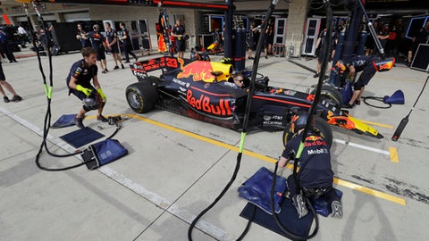 The crew of Red Bull driver Max Verstappen of the Netherlands, practice a pit stop for the Formula One U.S. Grand Prix auto race at the Circuit of the Americas, Thursday, Oct. 19, 2017, in Austin, Texas. (AP Photo/Eric Gay)