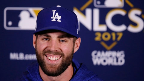 Los Angeles Dodgers' Chris Taylor talks during a news conference before Game 5 of baseball's National League Championship Series against the Chicago Cubs, Thursday, Oct. 19, 2017, in Chicago. (AP Photo/Charles Rex Arbogast)