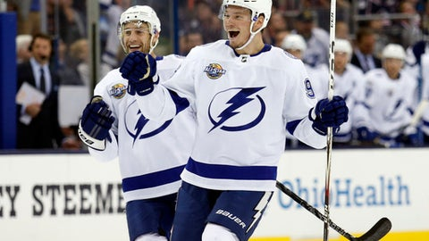 Tampa Bay Lightning defenseman Mikhail Sergachev, right, of Russia, celebrates his goal against the Columbus Blue Jackets with teammate defenseman Dan Girardi during the first period of an NHL hockey game in Columbus, Ohio, Thursday, Oct. 19, 2017. (AP Photo/Paul Vernon)