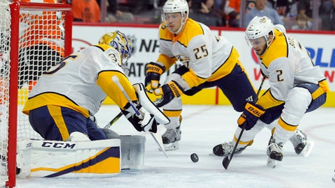Nashville Predators' Pekka Rinne, left, defends as Anthony Bitetto, right, looks to clear the puck from the crease during the second period of an NHL hockey game against the Philadelphia Flyers, Thursday, Oct. 19, 2017, in Philadelphia. (AP Photo/Tom Mihalek)