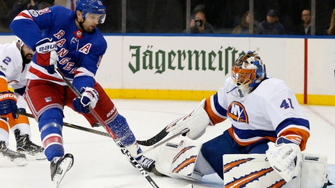 New York Rangers right wing Rick Nash (61) looks for an opening as he skates in front of New York Islanders goalie Jaroslav Halak (41) during the second period of an NHL hockey game in New York, Thursday, Oct. 19, 2017. (AP Photo/Kathy Willens)