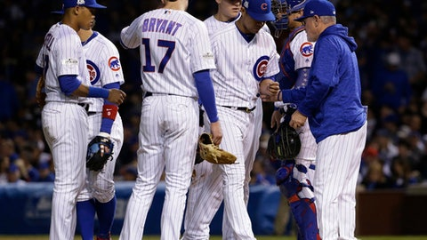 Chicago Cubs manager Joe Maddon (70) takes out starting pitcher Jose Quintana during the third inning of Game 5 of baseball's National League Championship Series against the Los Angeles Dodgers, Thursday, Oct. 19, 2017, in Chicago. (AP Photo/Nam Y. Huh)