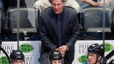 Colorado Avalanche coach Jared Bednar talks to his players during the first period of an NHL hockey game against the St. Louis Blues on Thursday, Oct. 19, 2017, in Denver. (AP Photo/David Zalubowski)