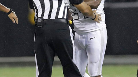 Oakland Raiders running back Marshawn Lynch (24) makes contact with back judge Greg Steed (12) during the first half of an NFL football game between the Raiders and the Kansas City Chiefs in Oakland, Calif., Thursday, Oct. 19, 2017. Lynch was ejected after the play. (AP Photo/Ben Margot)