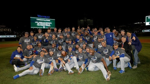 The Los Angeles Dodgers players celebrate after Game 5 of baseball's National League Championship Series against the Chicago Cubs, Thursday, Oct. 19, 2017, in Chicago. The Dodgers won 11-1 to win the series and advance to the World Series. (AP Photo/Matt Slocum)