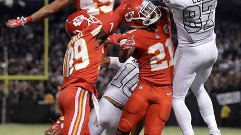Oakland Raiders tight end Jared Cook (87) catches a pass over Kansas City Chiefs defenders during the second half of an NFL football game in Oakland, Calif., Thursday, Oct. 19, 2017. The Raiders won 31-30. (AP Photo/Marcio Jose Sanchez)