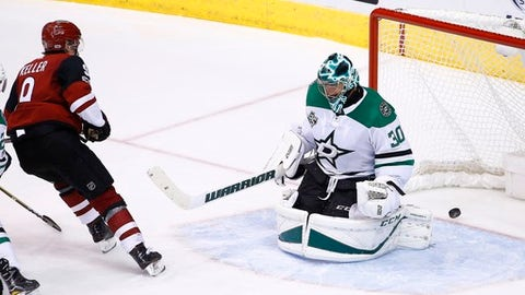 Arizona Coyotes center Clayton Keller, left, scores a goal against Dallas Stars goalie Ben Bishop (30) during the third period of an NHL hockey game Thursday, Oct. 19, 2017, in Glendale, Ariz. The Stars won 5-4. (AP Photo/Ross D. Franklin)