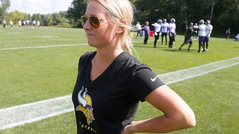 In this Sept. 5, 2017 photo, Kelly Kleine, the the Minnesota Vikings coordinator of college scouting, poses during NFL football practice in Eden Prairie, Minn. Kleine started with the Vikings as a public relations intern but has spent the last five years in the scouting department and has gradually added more responsibilities to her plate. Now she also works with special teams to evaluate players in addition to organizing the scouting department. (AP Photo/Jim Mone)