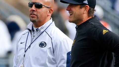 FILE - In this Nov. 21, 2015, file photo, Michigan head coach Jim Harbaugh, right, chats with Penn State head coach James Franklin before an NCAA college football game in State College, Pa. A day short of exactly one year since the victory against Ohio State, the Nittany Lions have another white out scheduled and another Big Ten power visiting for a nationally televised game. The difference this time is it will be no upset if No. 2 Penn State beats No. 19 Michigan on Saturday night. (AP Photo/Gene J. Puskar, File0