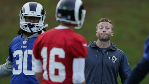 Los Angeles Rams' head coach Sean McVay, right, speaks with Los Angeles Rams' quarterback Jared Goff, centre, as Los Angeles Rams' running back Todd Gurley walks across the field during a training session at Pennyhill Park Hotel in Bagshot, England, Friday Oct. 20, 2017. The Los Angeles Rams are preparing for an NFL regular season game against the Arizona Cardinals in London on Sunday. (AP Photo/Tim Ireland)