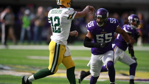 Green Bay Packers quarterback Aaron Rodgers (12) throws a pass before being hit by Minnesota Vikings outside linebacker Anthony Barr (55) and breaking his collar bone on the play during an NFL football game Sunday, Oct. 15, 2017, in Minneapolis. (Jeff Haynes/AP Images for Panini)