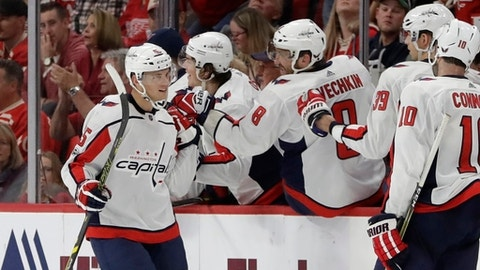 Washington Capitals left wing Andre Burakovsky is congratulated by teammates after scoring during the second period of an NHL hockey game against the Detroit Red Wings, Friday, Oct. 20, 2017, in Detroit. (AP Photo/Carlos Osorio)