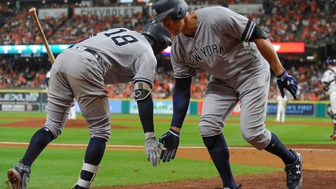 New York Yankees' Aaron Judge is congratulated by Didi Gregorius after hitting a home run during the eighth inning of Game 6 of baseball's American League Championship Series against the Houston Astros Friday, Oct. 20, 2017, in Houston. (AP Photo/Eric Christian Smith)