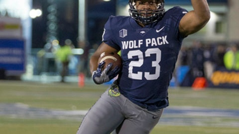 Nevada's Kelton Moore (23) runs against Air Force in the first half of an NCAA college football game in Reno, Nev., Friday, Oct. 20, 2017. (AP Photo/Tom R. Smedes)