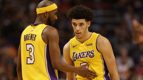 PHOENIX, AZ - OCTOBER 20:  Lonzo Ball #2 of the Los Angeles Lakers talks with Corey Brewer #3 during the first half of the NBA game against the Phoenix Suns at Talking Stick Resort Arena on October 20, 2017 in Phoenix, Arizona.The Lakers defeated the Suns 132-130.  NOTE TO USER: User expressly acknowledges and agrees that, by downloading and or using this photograph, User is consenting to the terms and conditions of the Getty Images License Agreement.  (Photo by Christian Petersen/Getty Images)
