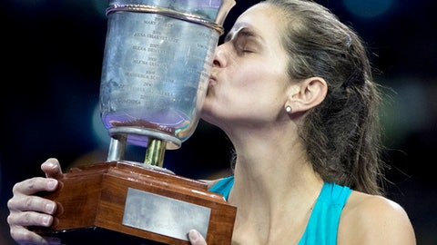 Julia Goerges of Germany kisses the trophy after winning the final match at the Kremlin Cup tennis tournament against  Daria Kasatkina of Russia, in Moscow, Russia, Saturday, Oct. 21, 2017. (AP Photo/Pavel Golovkin)