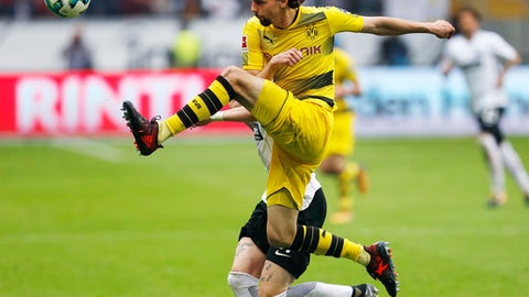 Dortmund's Neven Subotic kicks the ball during a German first division Bundesliga match between Eintracht Frankfurt and Borussia Dortmund in Frankfurt, Germany, Saturday, Oct. 21, 2017. (AP Photo/Michael Probst)
