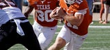 Texas QB Ehlinger being evaluated for head injury