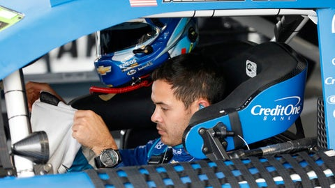 Kyle Larson prepares for a practice run for the NASCAR Cup Series auto race at Kansas Speedway in Kansas City, Kan., Saturday, Oct. 21, 2017. (AP Photo/Colin E. Braley)