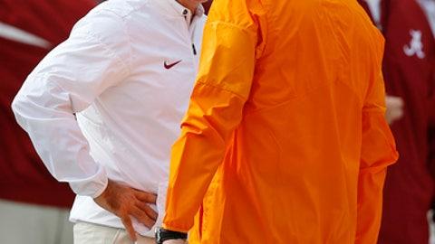 Alabama head coach Nick Saban, left, and Tennessee head coach Butch Jones talk before an NCAA college football game, Saturday, Oct. 21, 2017, in Tuscaloosa, Ala. (AP Photo/Brynn Anderson)