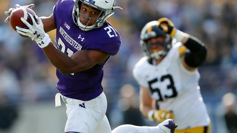 Northwestern's Justin Jackson, left, makes a catch in front of Iowa's Will Anthony during the second half of an NCAA college football game Saturday, Oct. 21, 2017, in Evanston, Ill. (AP Photo/Jim Young)