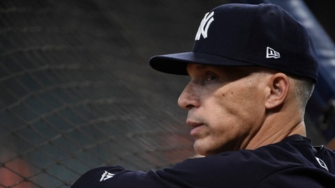 New York Yankees manager Joe Girardi watches batting practice before Game 7 of the American League Championship Series baseball game against the Houston Astros Saturday, Oct. 21, 2017, in Houston. (AP Photo/Eric Christian Smith)