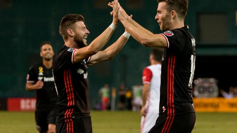 WASHINGTON, DC - SEPTEMBER 23: D.C. United forward Paul Arriola (13) with forward Patrick Mullins (16) after Mullins had scored his fourth goal during a MLS match between D.C United and the San Jose Earthquakes on September 23, 2017 at RFK Stadium, in Washington DC.  (Photo by Tony Quinn/Icon Sportswire via Getty Images)