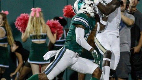 South Florida wide receiver Darnell Salomon (3) catches a touchdown over Tulane cornerback Donnie Lewis Jr. (21) during the first half of an NCAA college football game in New Orleans, Saturday, Oct. 21, 2017. (AP Photo/Derick E. Hingle)