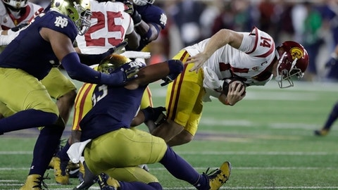 Southern California quarterback Sam Darnold is sacked by Notre Dame defensive lineman Khalid Kareem during the first half of an NCAA college football game, Saturday, Oct. 21, 2017, in South Bend, Ind. (AP Photo/Carlos Osorio)