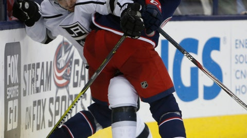 Los Angeles Kings' Nick Shore, left, and Columbus Blue Jackets' Alexander Wennberg, of Sweden, fight for a loose puck during the third period of an NHL hockey game Saturday, Oct. 21, 2017, in Columbus, Ohio. The Kings beat the Blue Jackets 6-4. (AP Photo/Jay LaPrete)