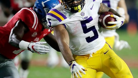 LSU running back Derrius Guice (5) runs through Mississippi defenders for a long gain in the second half of an NCAA college football game in Oxford, Miss., Saturday, Oct. 21, 2017. No. 24 LSU won 40-24. (AP Photo/Rogelio V. Solis)