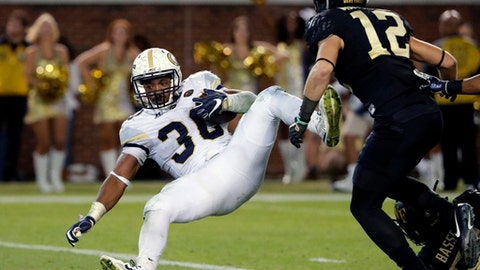 Georgia Tech's KirVonte Benson scores a touchdown past the defense of Wake Forest's Luke Masterson, right, in the fourth quarter of an NCAA college football game in Atlanta, Saturday, Oct. 21, 2017. (AP Photo/David Goldman)
