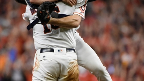 Houston Astros' Lance McCullers Jr. leaps in the arms on Brian McCann after Game 7 of baseball's American League Championship Series against the New York Yankees Saturday, Oct. 21, 2017, in Houston. The Astros won 4-0 to win the series. (AP Photo/Eric Christian Smith)