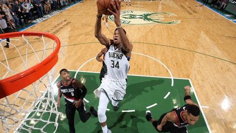 Milwaukee, WI - OCTOBER 21: Giannis Antetokounmpo #34 of the Milwaukee Bucks dunks and put his team in the lead against the Portland Trail Blazers on October 21, 2017 at the BMO Harris Bradley Center in Milwaukee, Wisconsin. NOTE TO USER: User expressly acknowledges and agrees that, by downloading and or using this Photograph, user is consenting to the terms and conditions of the Getty Images License Agreement. Mandatory Copyright Notice: Copyright 2017 NBAE (Photo by Gary Dineen/NBAE via Getty Images)