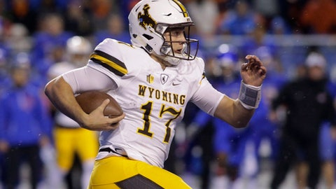 Wyoming quarterback Josh Allen (17) runs the ball during the first half of an NCAA college football game against Boise State in Boise, Idaho, Saturday, Oct. 21, 2017. (AP Photo/Otto Kitsinger)