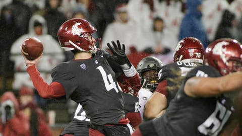 Washington State quarterback Luke Falk (4) throws a pass during the first half of an NCAA college football game against Colorado in Pullman, Wash., Saturday, Oct. 21, 2017. (AP Photo/Young Kwak)