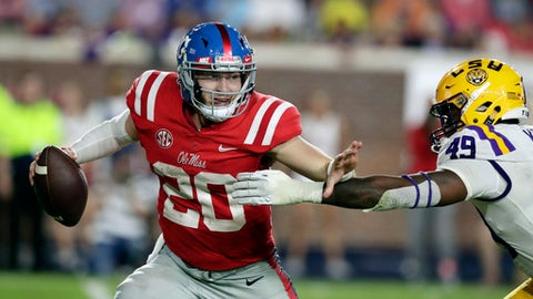 Mississippi quarterback Shea Patterson (20) attempts to fight off LSU linebacker Arden Key (49) during the second half of an NCAA college football game in Oxford, Miss., Saturday, Oct. 21, 2017. No. 24 LSU won 40-24. (AP Photo/Rogelio V. Solis)